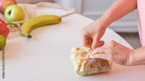 Woman hands wrapping a healthy sandwich in beeswax food wrap Canvas Print