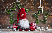 Christmas Composition With Gnome And Festive Decorations On Wooden Background. Christmas Or New Year Greeting Card.