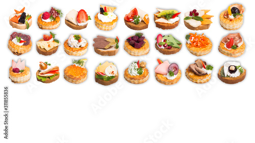 Assortment of tasty canapes on white background © grigoryepremyan