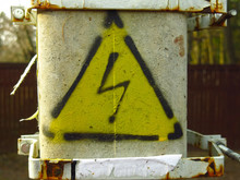 Yellow Sign With Lightning: Dangerous, High Voltage