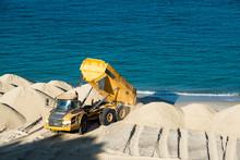 Dump Truck Working On A Beach