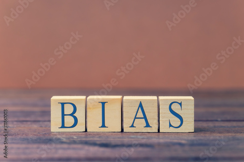 the word bias on wooden blocks blue text Canvas Print