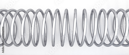 Vászonkép Stretched metal spring on a white background.