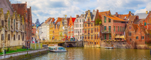 Foto Ghent, Belgium old colorful traditional houses along the canal and boats, panora