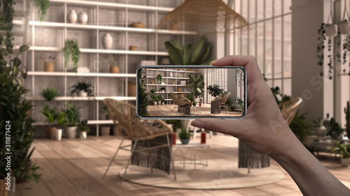 Hand holding smart phone, AR application, simulate furniture and interior design product in real home, architect designer concept background, winter garden, lounge interior design