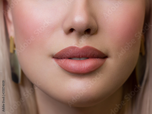 Obraz Sexual full lips. Natural gloss of lips and woman's skin. The mouth is closed. Increase in lips, cosmetology. Natural lips. Great summer mood with open eyes. fashion jewelry. Pink lip gloss - fototapety do salonu