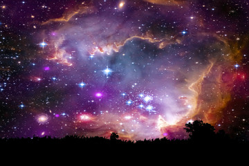 nebula and galaxy on space back on silhouette mountain hill and night sky