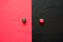 Red Dice On Black Background And Black Dice On Red Background. Red Dice Shows One And Black Dice Shows Six.