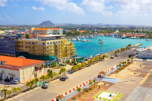 Photo View of the main harbor on Aruba looking from a cruise ship down over the city and boats