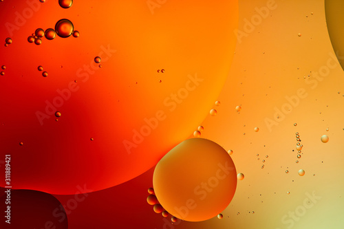 Beautiful abstract orange and red color background from mixed water and oil