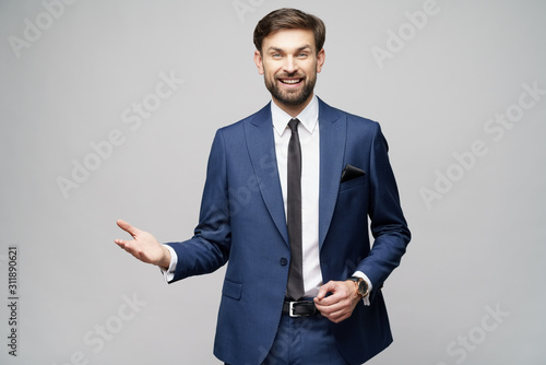 Portrait of a young businessman pointing on a copyspace with his finger
