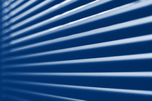 Classic Blue Tone Close-up Modern Plastic Shutter Blinds In Office Room. Trendy 2020 Color Pantone Jalousie