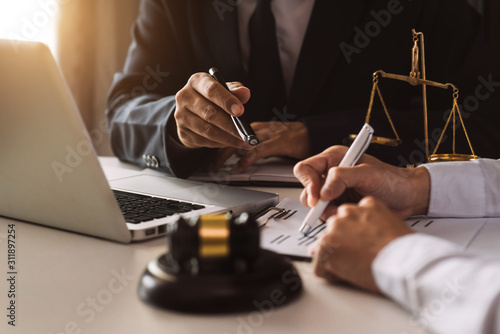 Fototapety, obrazy: business people and lawyers discussing contract papers sitting at the table. Concepts of law, advice, legal services. in morning light