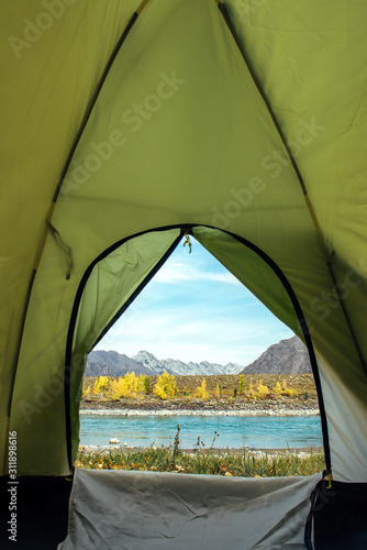 View from the tourist tent on beautiful landscape with turquoise river and high mountains under blue sky Wallpaper Mural