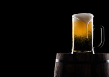 Cold Glass Of Craft Beer On Old Wooden Barrel