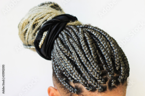 Obraz na plátně Young afro with blonde Box braids, African hair style also known as Kanekalon braids