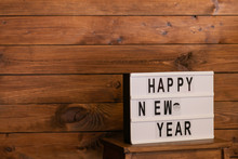 New Year Lettering On Wooden ...