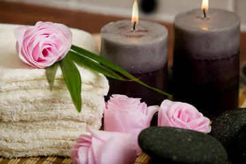 Soap pink roses.  candles and face towels in  a spa