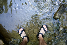 Young Man Legs Dipped In Water...