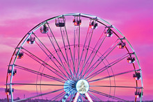 Closeup Colorful Ferris Wheel Against Sunset Pink Sky.