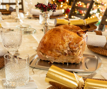 Turkey Breast Crown Ready For Carving On Traditional British Christmas Lunch Table Setting