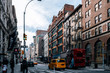 Early morning traffic and tourist walking on the Broadway in SOHO New York City