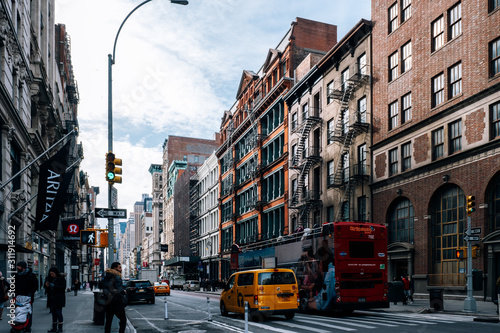 Early morning traffic and tourist walking on the Broadway in SOHO New York City - 311914692
