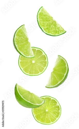 Valokuvatapetti Collage of falling limes on white background