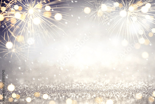 Fototapeta Gold and silver Fireworks and bokeh in New Year eve and copy space