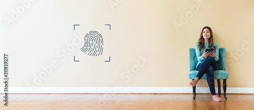 Fingerprint biometric identity with young woman holding a tablet computer Canvas Print