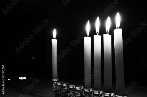 Fényképezés  Festival of Lights, Hanukkah, chanukah, candles lit on a smooth marble stone