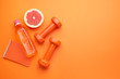canvas print picture - Dumbbells with notebook, grapefruit and bottle of water on color background