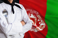 Afghanistan Domestic Food Concept. Professional Chef In White Uniform Is Standing With Metal Spatula. Copy Space For Text.