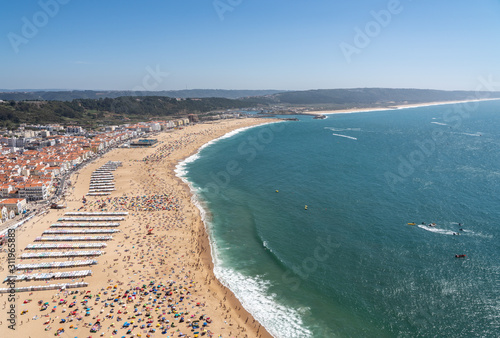 Fotografia, Obraz  Crowded beach of Nazare from above with tourists relaxing on the sand