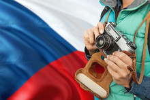 Czech Republic Photographer Concept. Close-up Adult Woman Holding Retro Camera On National Flag Background. Adventure And Traveler Theme.