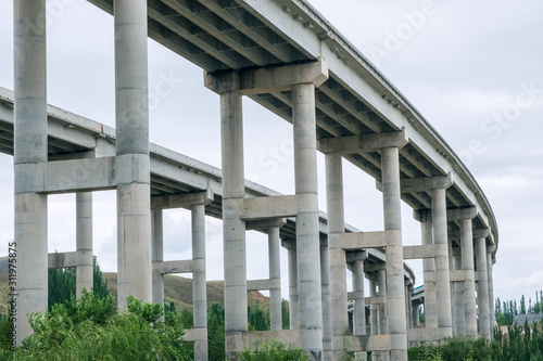 Fotografia, Obraz Concrete pillars or trestle under the viaduct or highway bridge