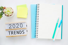 2020 Trends On Wooden Box, Blank Paper Notebook And Pen On White Table Background, New  Year Business Trend Mock Up, Template, Copy Space For Text