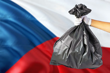 Czech Republic Environmental Protection Concept. The Male Hand Holding A Garbage Bag On National Flag Background. Ecological And Recycling Theme With Copy Space.