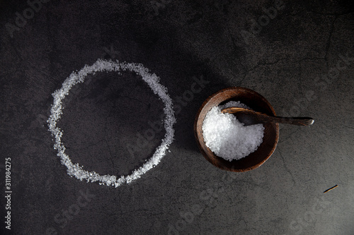Salt circle and wooden salt bowl and spoon isolated on concrete flat lay Canvas-taulu