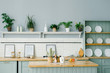 canvas print picture - Scandinavian style in the kitchen interior in white and mint colors. White plates, houseplants