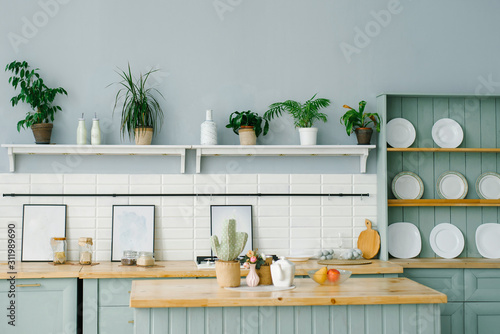 Fotografiet  Scandinavian style in the kitchen interior in white and mint colors