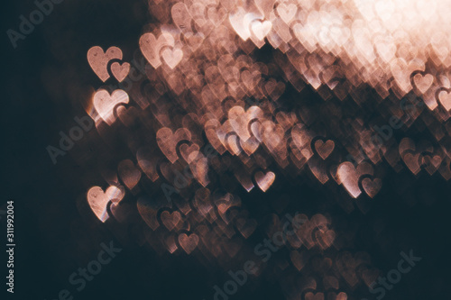 Blurred bokeh with hearts bokeh style. copy space for adding your text or use for background.