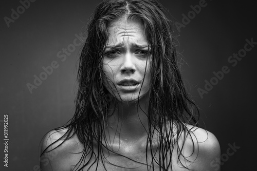 Obraz Expressive black white portrait of a young attractive girl with wet dark hair - fototapety do salonu