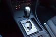 Automatic gear knob in the passenger compartment in black for driving and acceleration. Abstract image of fast speed.