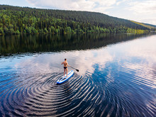 Man Rowing Oar On Sup Board Blue Sea Water. Aerial Top View Paddleboard