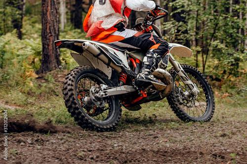 Fotomural  motocross rider in trail enduro race