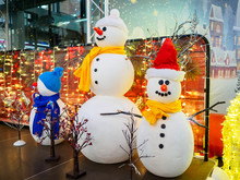 Three Funny Snowmen On Stage A...