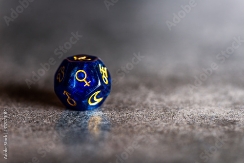 Photo Blue Astrology Dice with symbol of the planet Venus on grey background