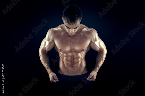 Strong athletic man fitness model torso showing six pack abs, perfect abs, shoulders, biceps, triceps and chest Wallpaper Mural