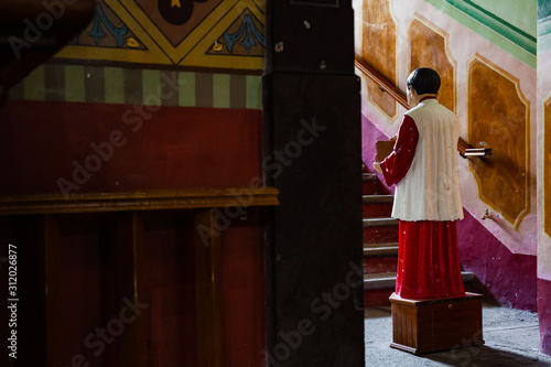 Photo acolyte with donation box for gifts in church